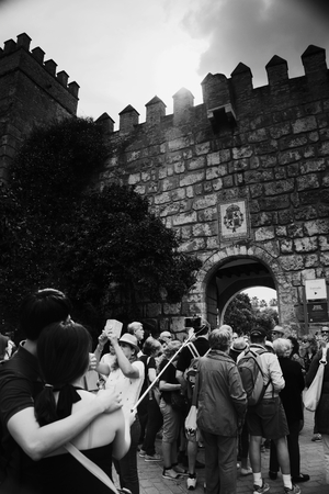 Seville, Spain, 14th September 2016 - People in front of the walls of the old Alcazar Editorial