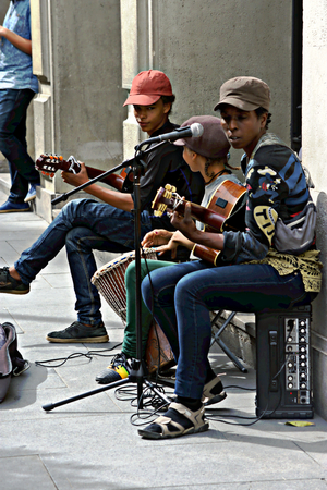 Seville, Spain, 14th September 2016 - Very young musicians performing in the street Editorial