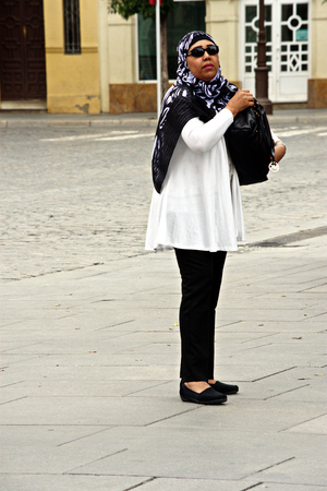 Seville, Spain, 14th September 2016, Muslim lady standing in the street