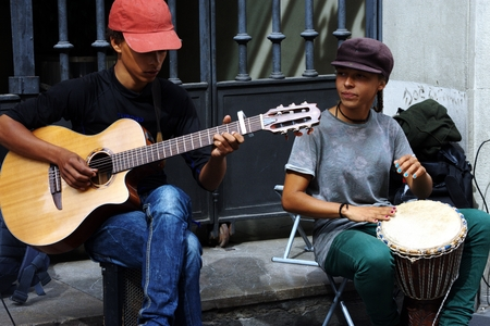 Seville, Spain, 14th September, 2016 - Very young musicians performing in the street