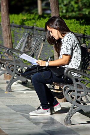 Sevilla (Spain) 27th September 2016 - Urban life - Young lady reading outrdoors Editorial