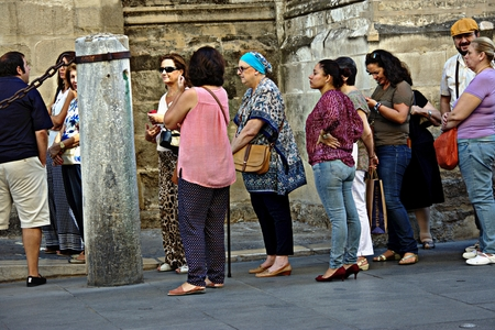 Sevilla (Spain) 27th September 2016 - Urban life - People quieing to visit a monument Editorial