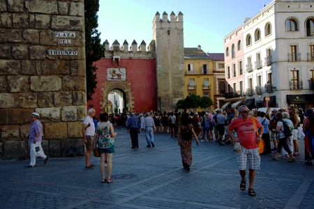 Seville, Spain, 27th September, 2016 - Urban life  - People queuing to visit a monument Editorial