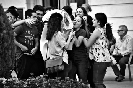 Granada, Spain, 1st October 2016, Urban life: Young people acting in the street Editorial