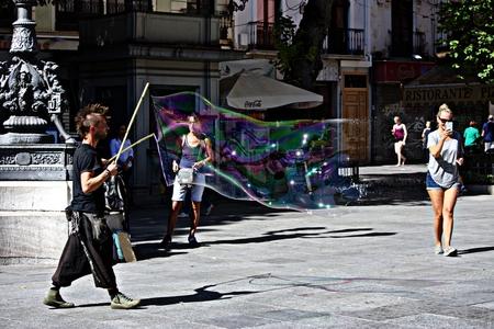 Granada, Spain, 1st October 2016 , Urban life: Street artist making bubbles Editorial