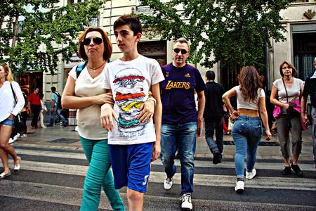 Granada, Spain, 1st October 2016 , Urban life: people crossing the street