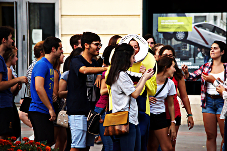 Granada, Spain, 1st October 2016 , Urban life: Group of youngsters acting in the street Editorial