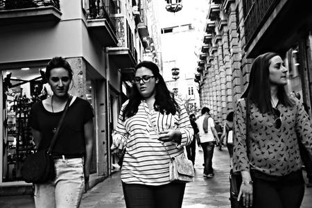 Granada, Spain, 1st October 2016- Urban life, Young ladies walking in the street