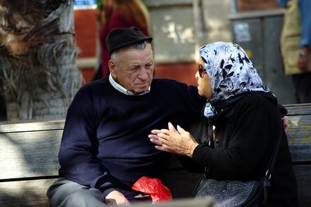 sain: Seville, Sain, 1st November 2016 - Urban life - Old couple talking in the street