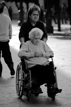 sain: Seville, Sain, 1st November 2016 - Urban life - Invalid lady in the street Editorial