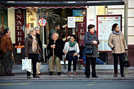 loitering: Seville (Spain) 21st December 2016 - Urban life - People loitering in nthe street Editorial