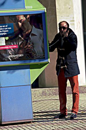 loitering: Seville (Spain) 21st December 2016 -Urban life - Man loitering in the street