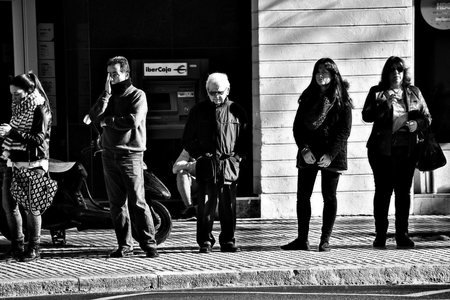 loitering: Seville, 21st December 2016 - Urban life - People loitering in the street