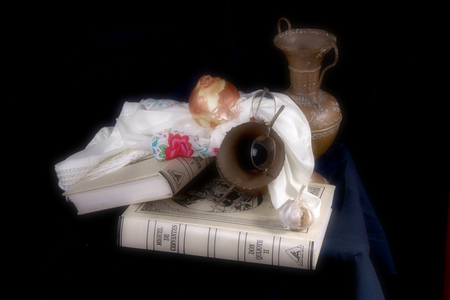 Still life with copper plates and books