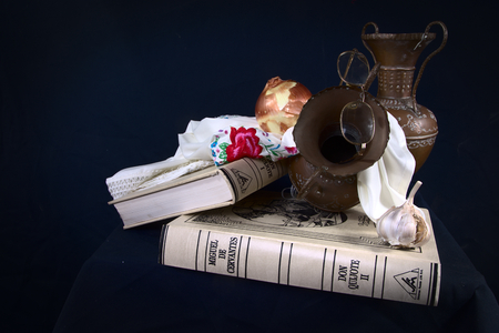 Still life with books and copper pots Stock Photo