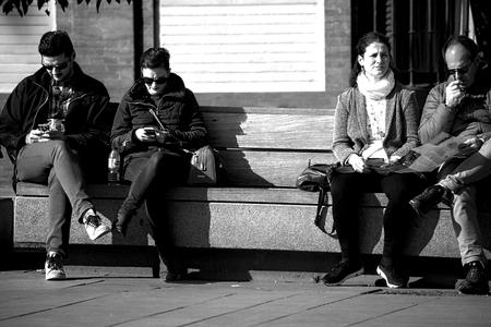 Seville, Spain, 24th January 2018 - Urban life - people sitting outdoors