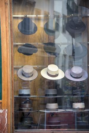 Urban life: A shop window. Selling hats Stock Photo