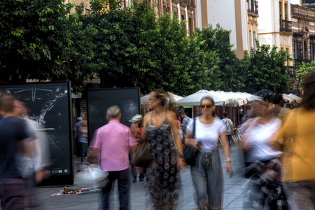 People in montion in Triana district (Seville)