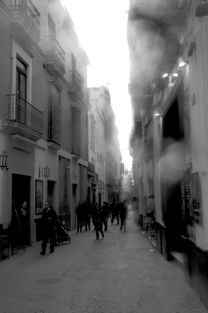 Seville, 19th February 2019. This is an urban photo. A narrow street in the center of seville Редакционное
