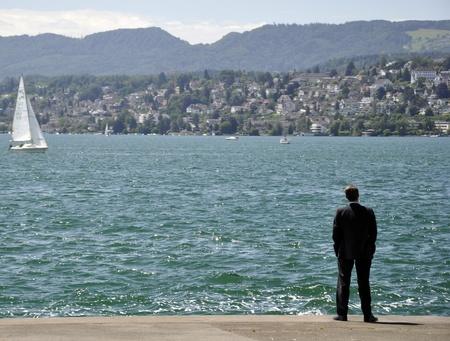 utopian: Businessman in lake