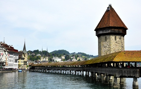 Famous covered wooden footbridge in Lucerne, Switzerland photo