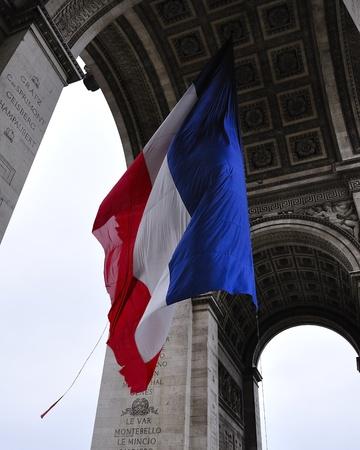 Paris - France Arc de Triomphe, French flag  Stock Photo