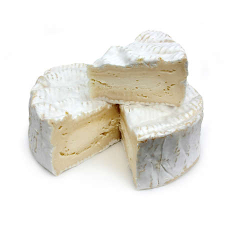 Portion of French cheese - Camembert (on a white background photo