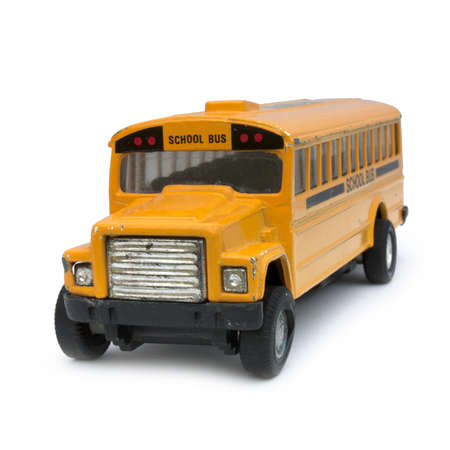 Yellow school bus toy (on a white background) Stock Photo - 12052873