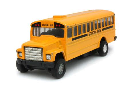Yellow school bus toy (on a white background) Stock Photo - 12052872