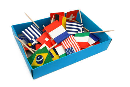 Box of miniature flags from different countries  isolated   Stock Photo