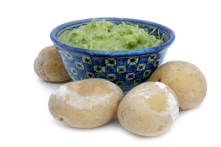 mojo: Canarian specialty - papas potatoes with green mojo  isolated