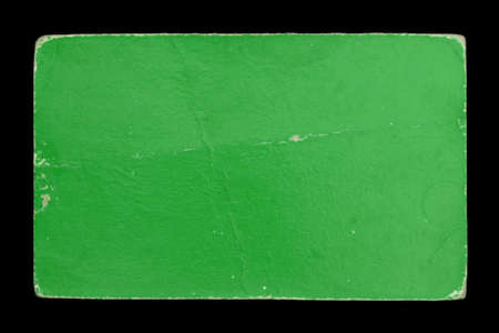 recall: Old green cardboard label on black background