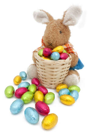 Easter bunny plush with a basket of colored eggs photo