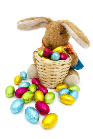 Easter bunny plush with a basket of colored eggs Stock Photo - 12667395