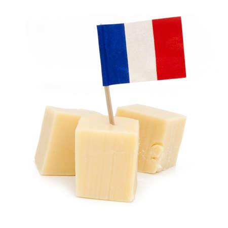 Cubos de queso franc�s aislados Foto de archivo
