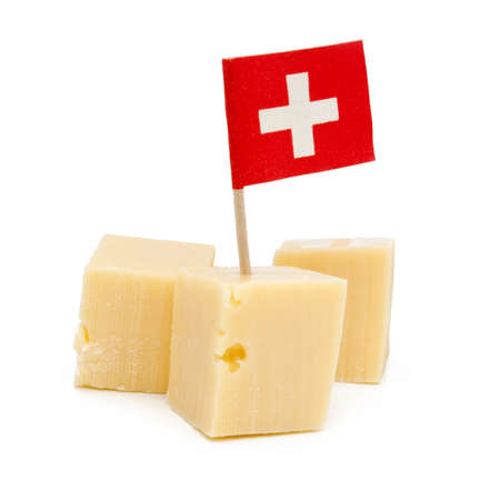 Cubos de queso suizo aislado Foto de archivo