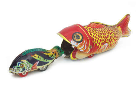 the fittest: Fish tin toy on white background