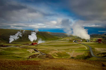 geothermal: A geothermal power plant on the top of a mountain. Stock Photo