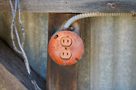 conduit: A rusty covered outlet Stock Photo