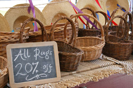 Baskets and rugs for sale at an outdoor market