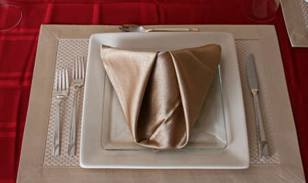 formal place setting: Formal place setting with folded napkin