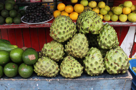 roadside stand: Fruit stand in Peru with Chirimoya, avocado and lemons Stock Photo
