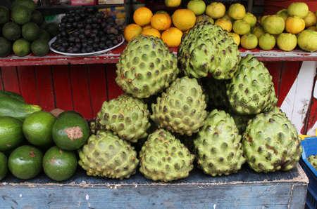 chirimoya: Fruit stand in Peru with Chirimoya, avocado and lemons Stock Photo