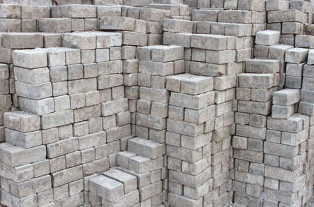 large group of objects: Stacked pile of cement bricks Stock Photo