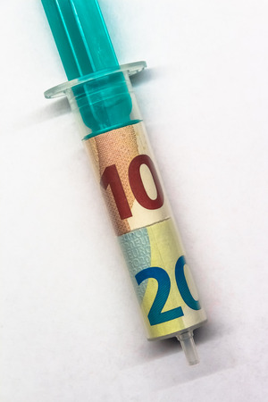 Aerial close-up of a Syringe with Euro Banknotes