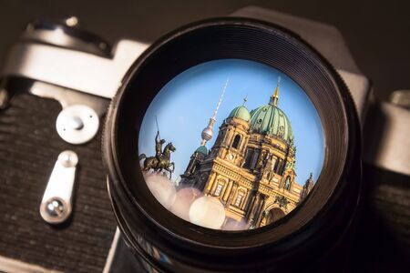 Reflection of Berlins Main Cathedral in the Lens of a Vintage SLR Camera