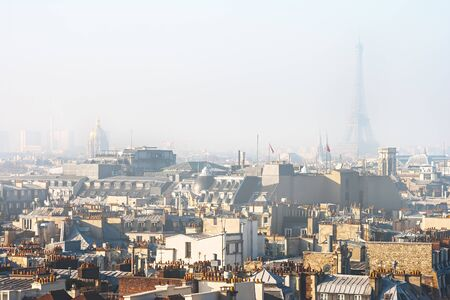 View of Central Part of Paris (France) in Smog with the Eiffel Tower in Background