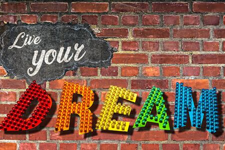 The Words Live Your Dream Written on a Red Brick Wall
