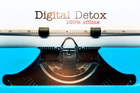Image of an Old-Fashioned Typewriter showing the Words Digital Detox and 100 Percent Offline