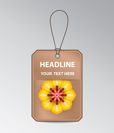Bronze tag with string and yellow flower.